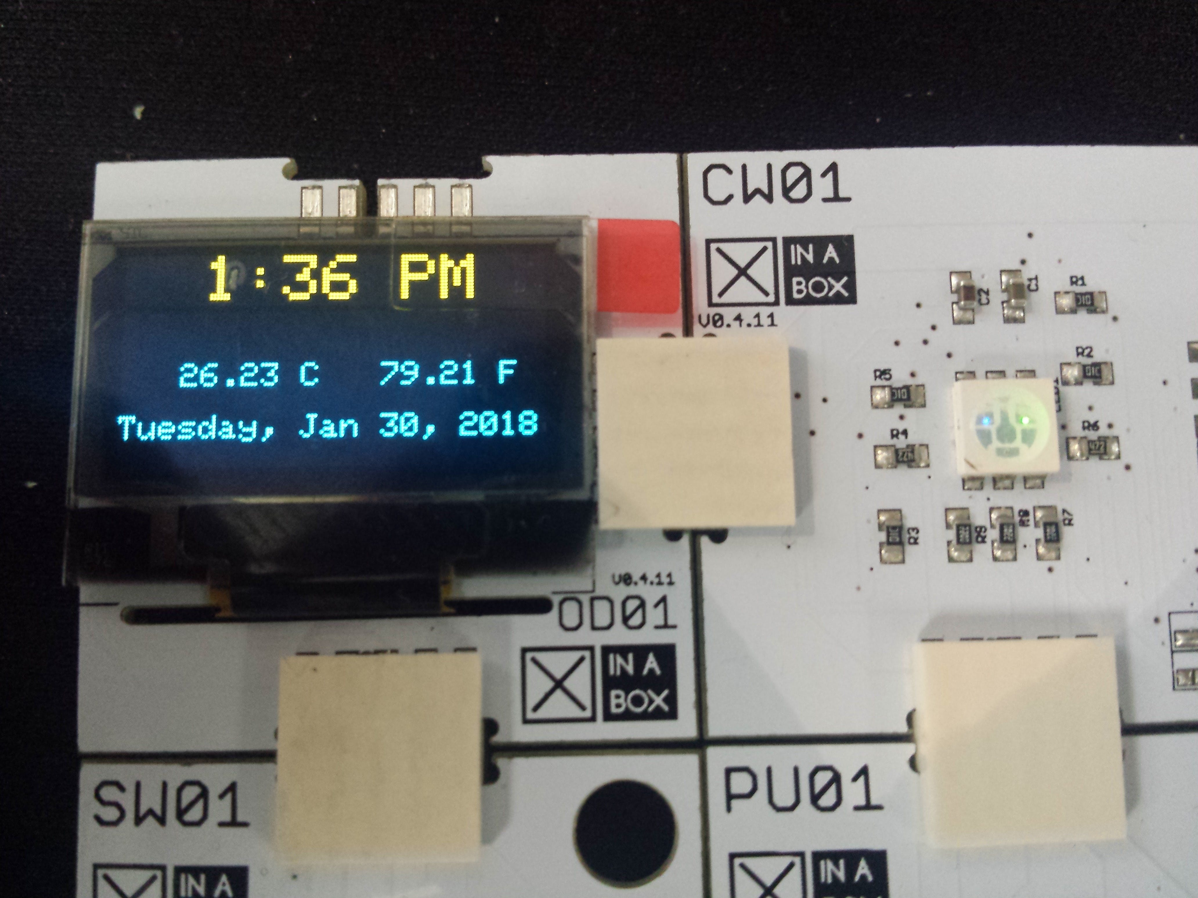 OLED displaying date, time and temperature