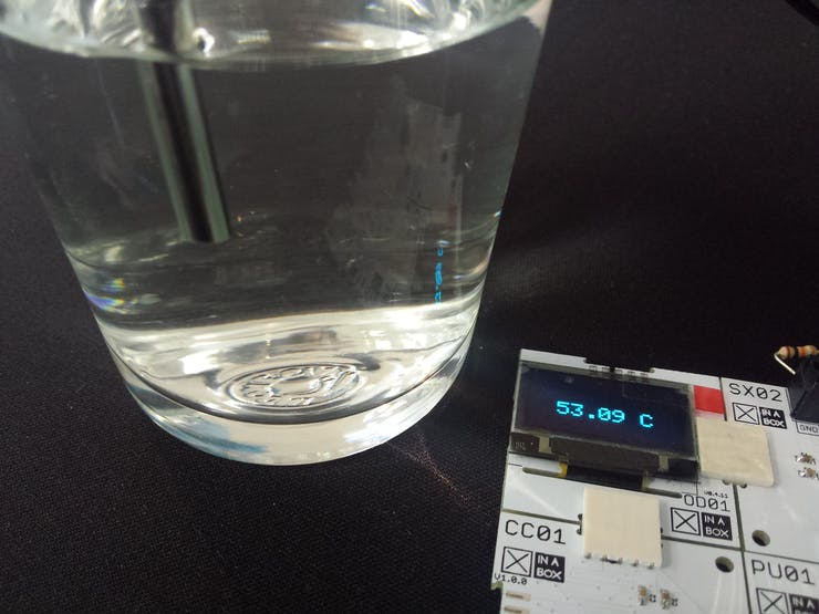 Thermistor measuring temperature of water in a glass