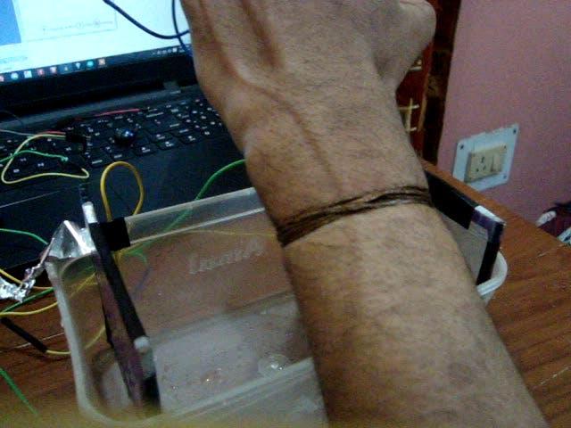 bare copper wire tied to left wrist