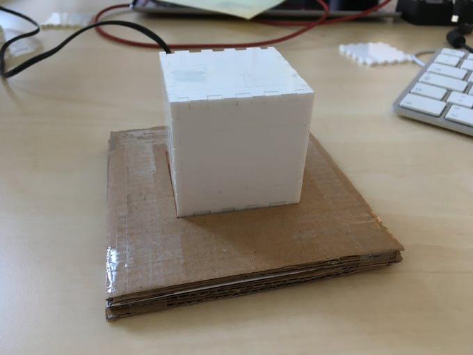 Assembled cube on the prototype inductive charger base