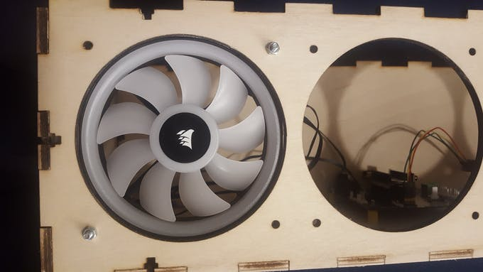 Fitting fans in the wooden enclosure (no idea why Hackster has this image up-side-down).