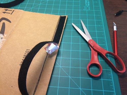 Inward facing with Velcro strip.
