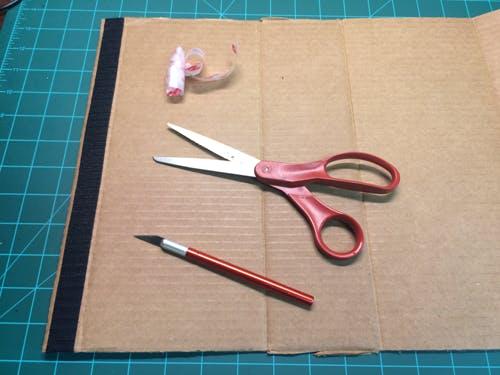 Outward facing with Velcro strip.