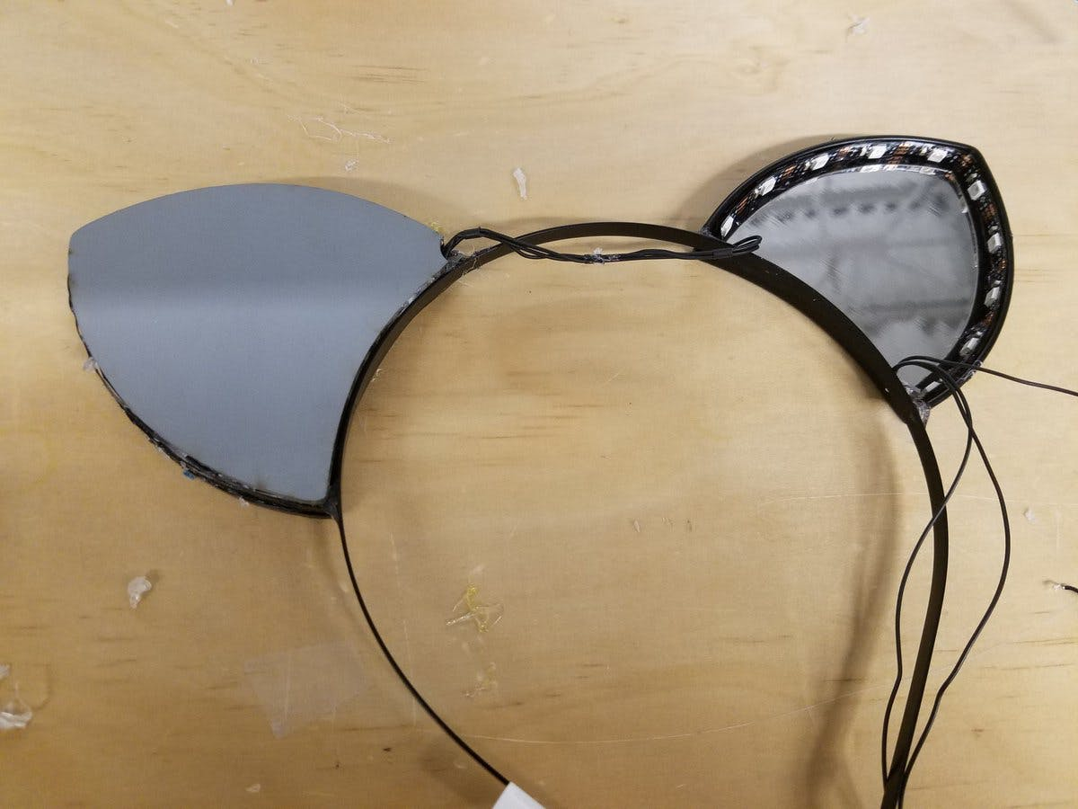 Assembling the ears. I cut notches in the back mirrors to allow space for the wires to thread through.