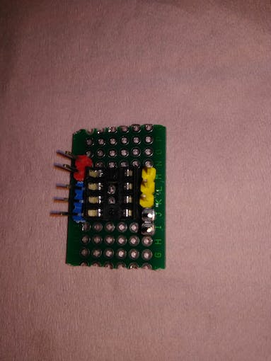 Laying out IC base, colorful male pins on protoboard for Beacon