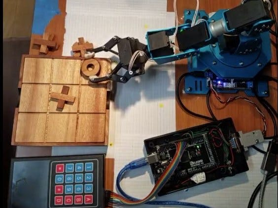 Tic-Tac-Toe Board Game with Robotic Arm