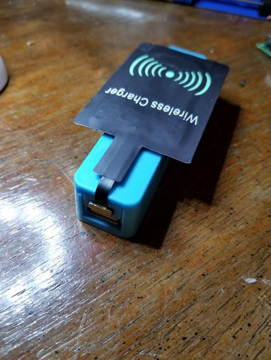 Wireless charger receiver attached to battery