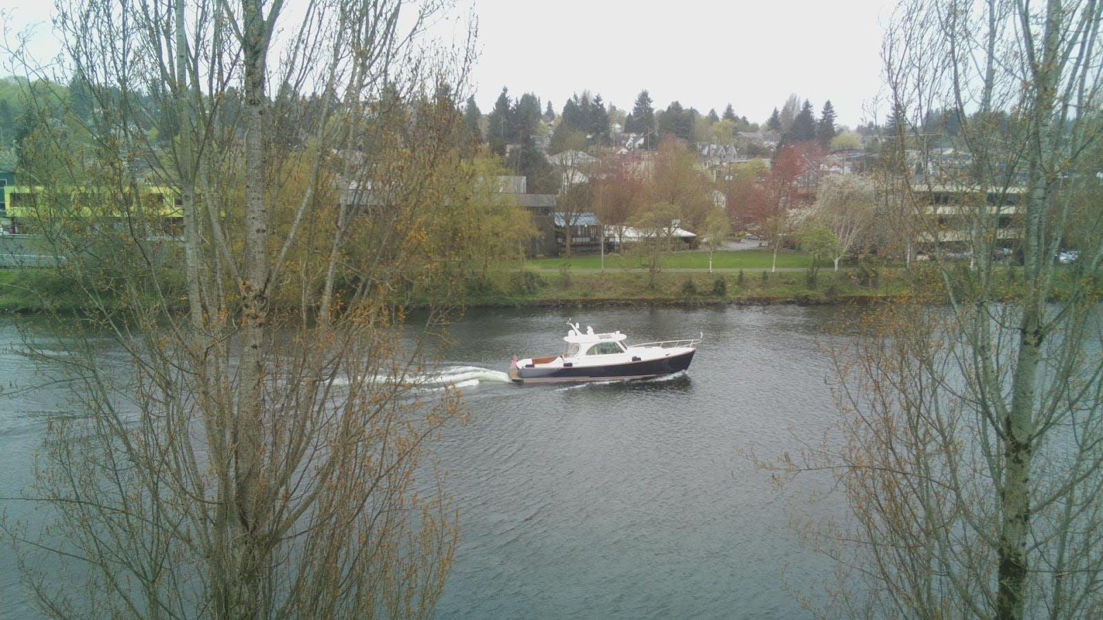 Result 0: lakeside/lakeshore (prob=0.441406 Result 1: canoe (prob=0.115173)