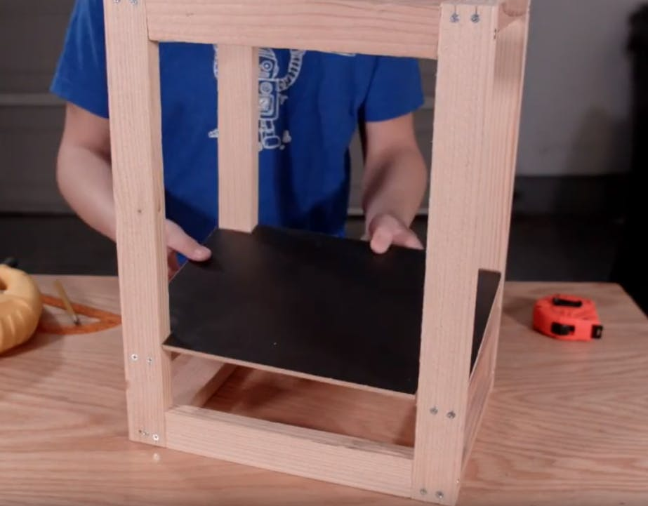 Setting the drink platform into the frame