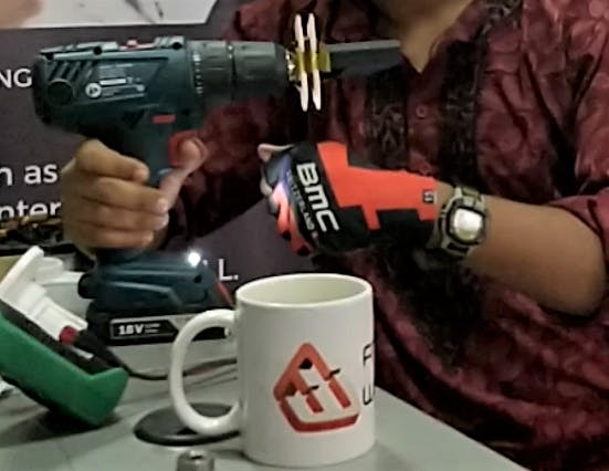 Figure 6: Wire being wound around the jig with the help of a hand drill and drill bit