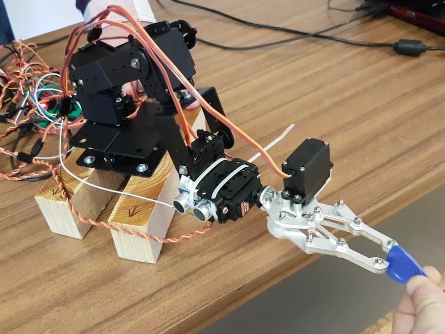 Object Avoiding FSM Robot Arm
