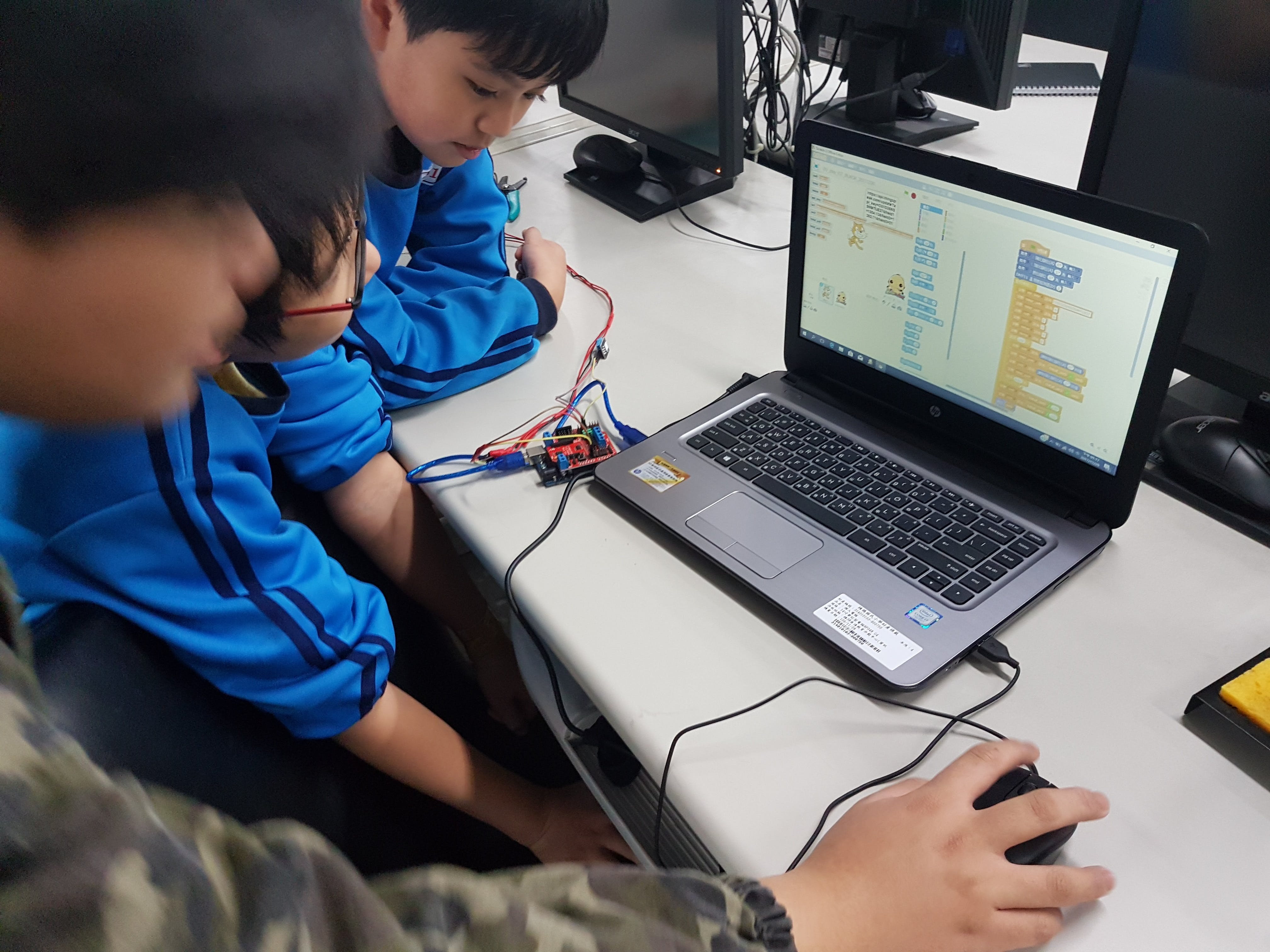 We use Scratch 2 + Transformer(middle ware) to program.