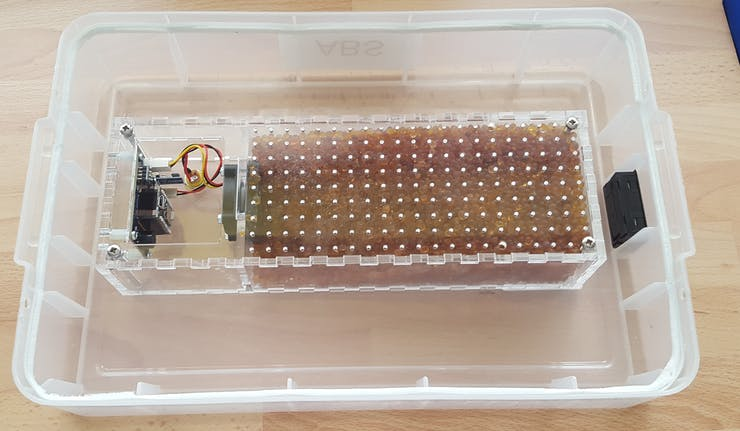 Cartridge filled with Silica gel and attached to the lid.