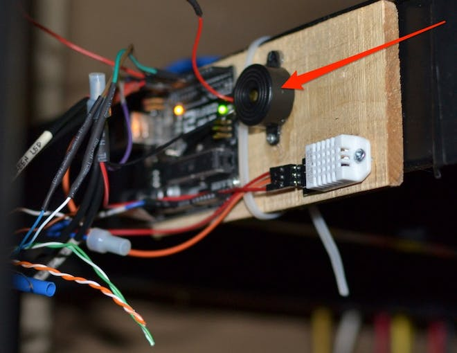 Buzzer pulled from a broken RC car serves as audible feedback.