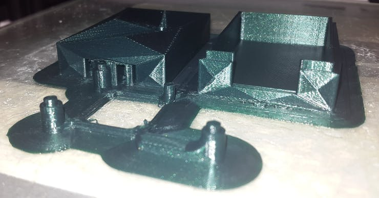 the 3D printed case: the two big parts are top and bottom parts of the case and the small one is the mini-stand for the LoRa module