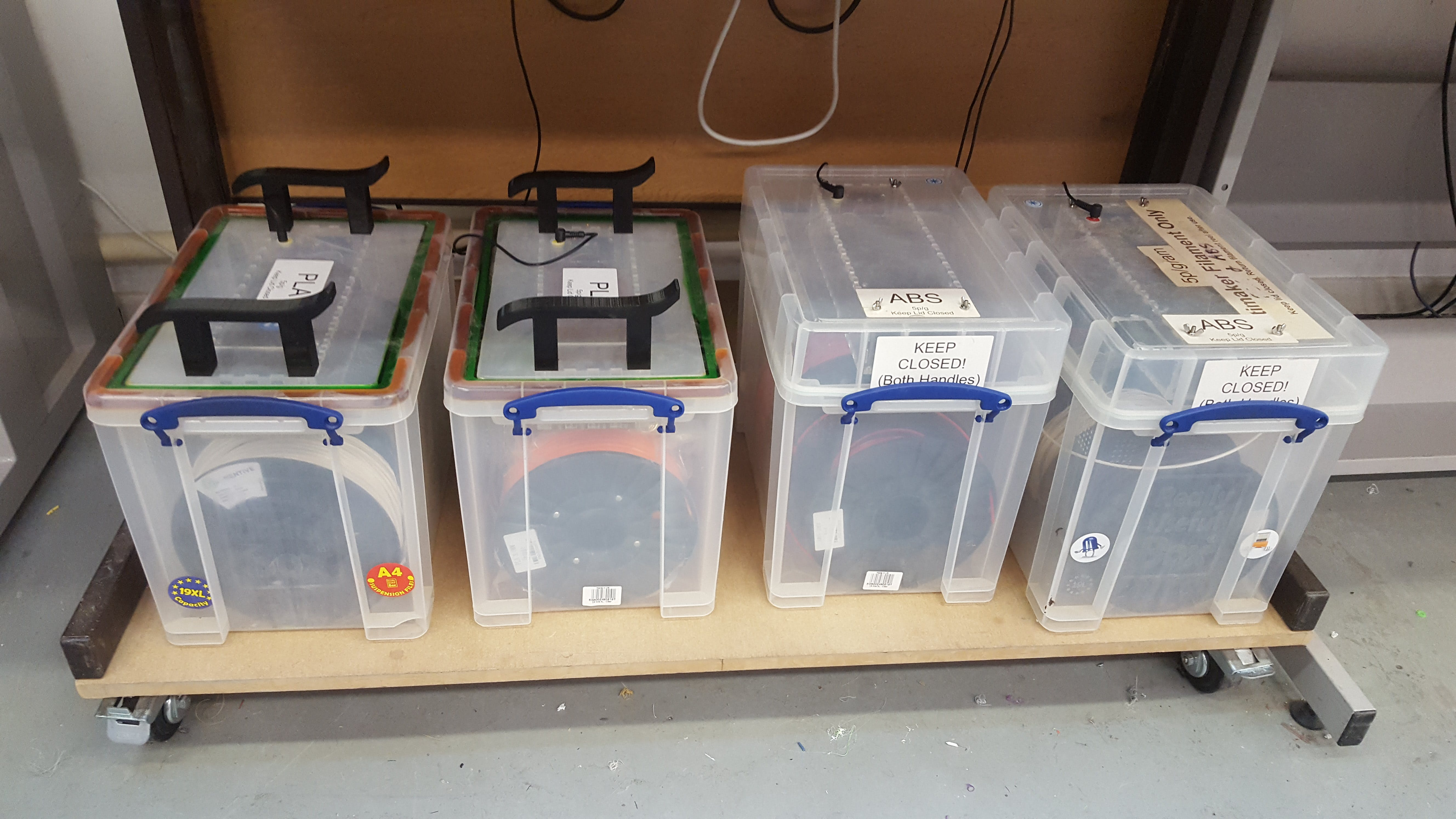 Filament Storage at Cambridge MakeSpace New lid design on the left, old style on the right