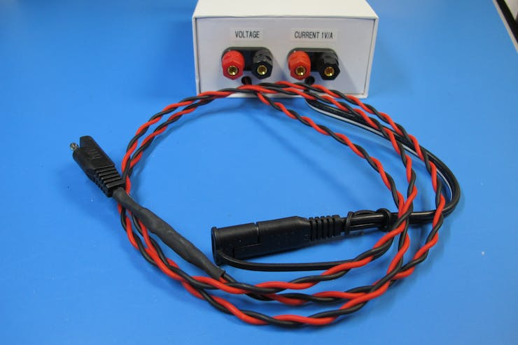 Short black cable connects to the charger, Long red & black cable goes to the battery