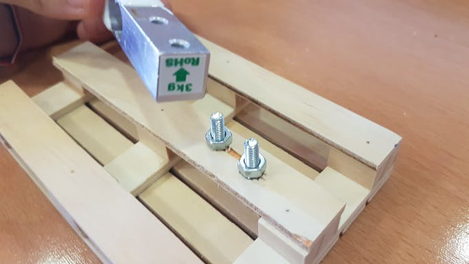Screws introduced with hex nuts to sepparate the base from the sensor