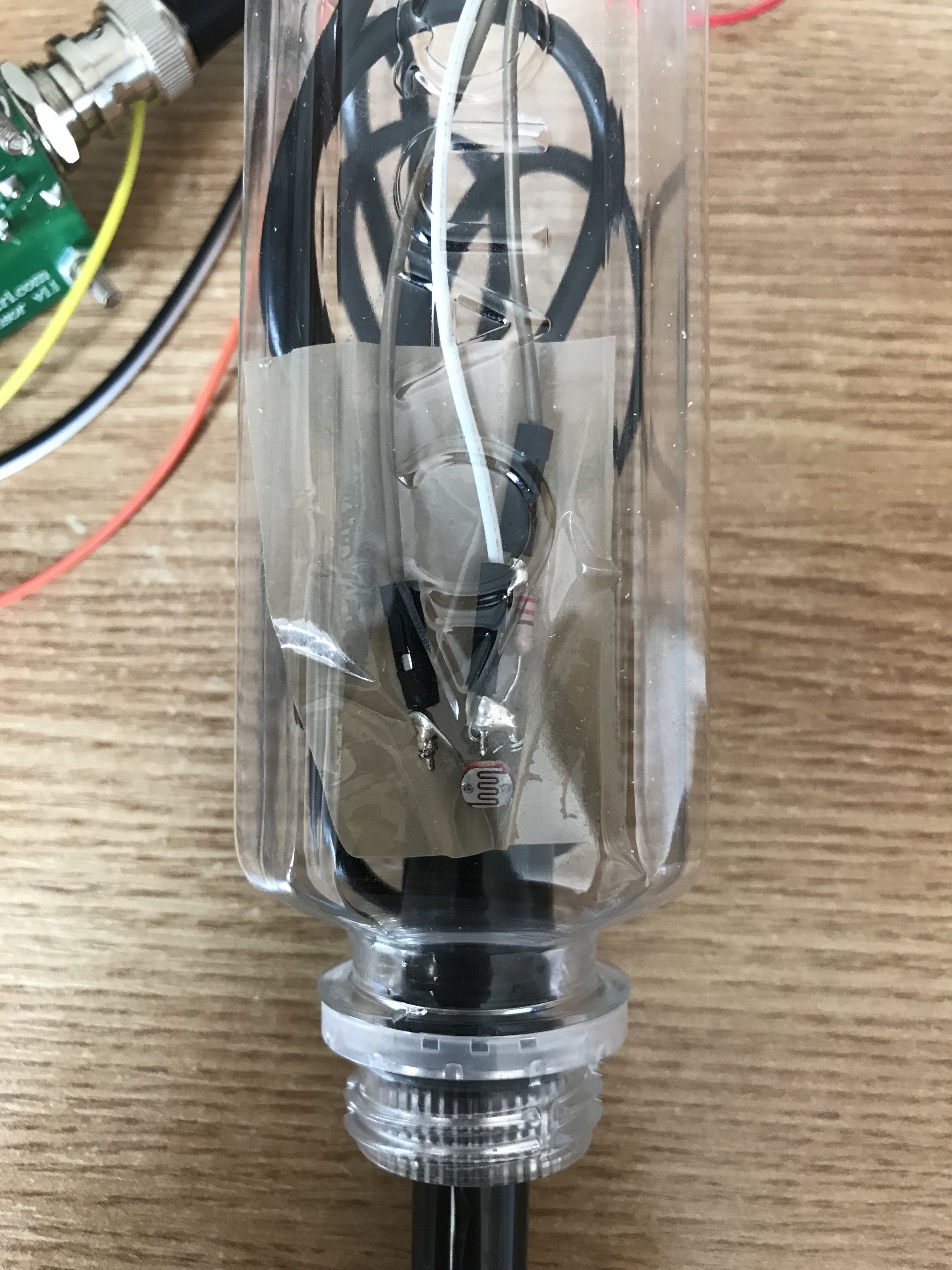 Tape the photoresistor close to the bottle's hole