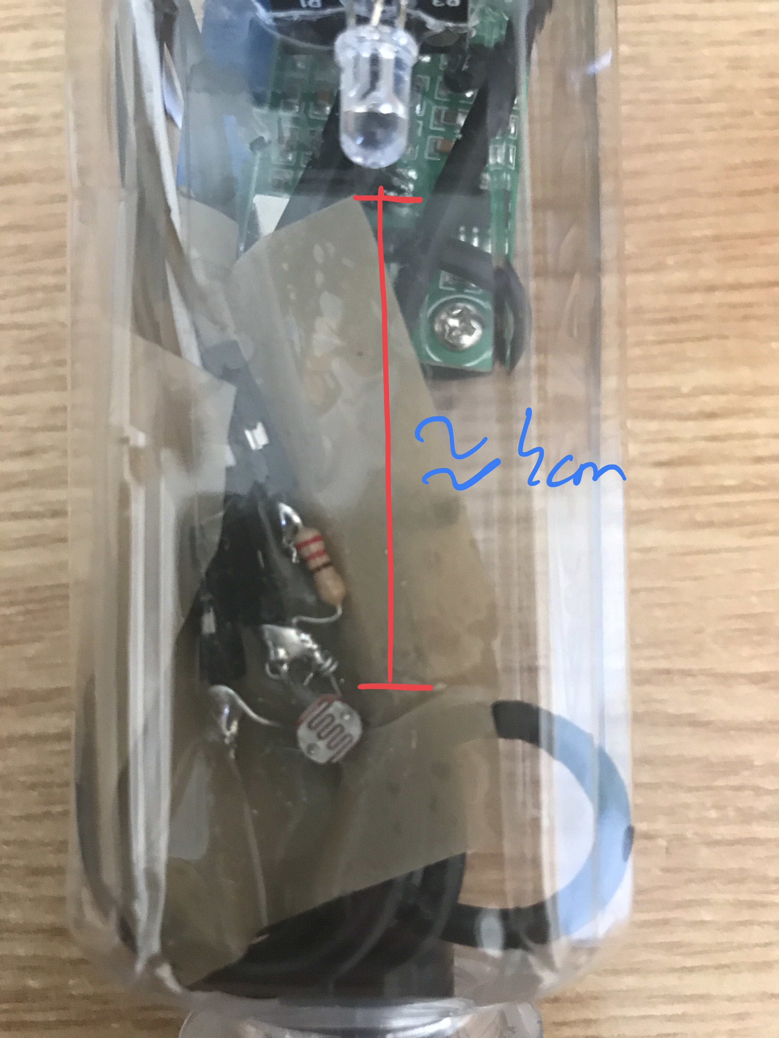 Tape the LED around 4cm above the photoresistor on the outside of the bottle, ensure that it is just above the water level sensor