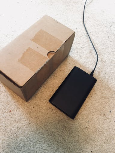 Depicts the Walabot placed on the floor in front of a 10cm tall box.