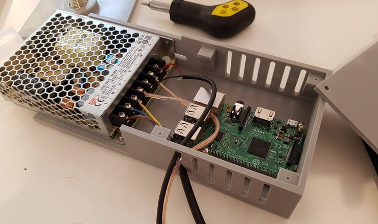 The PSU and the Pi are screwed to the case