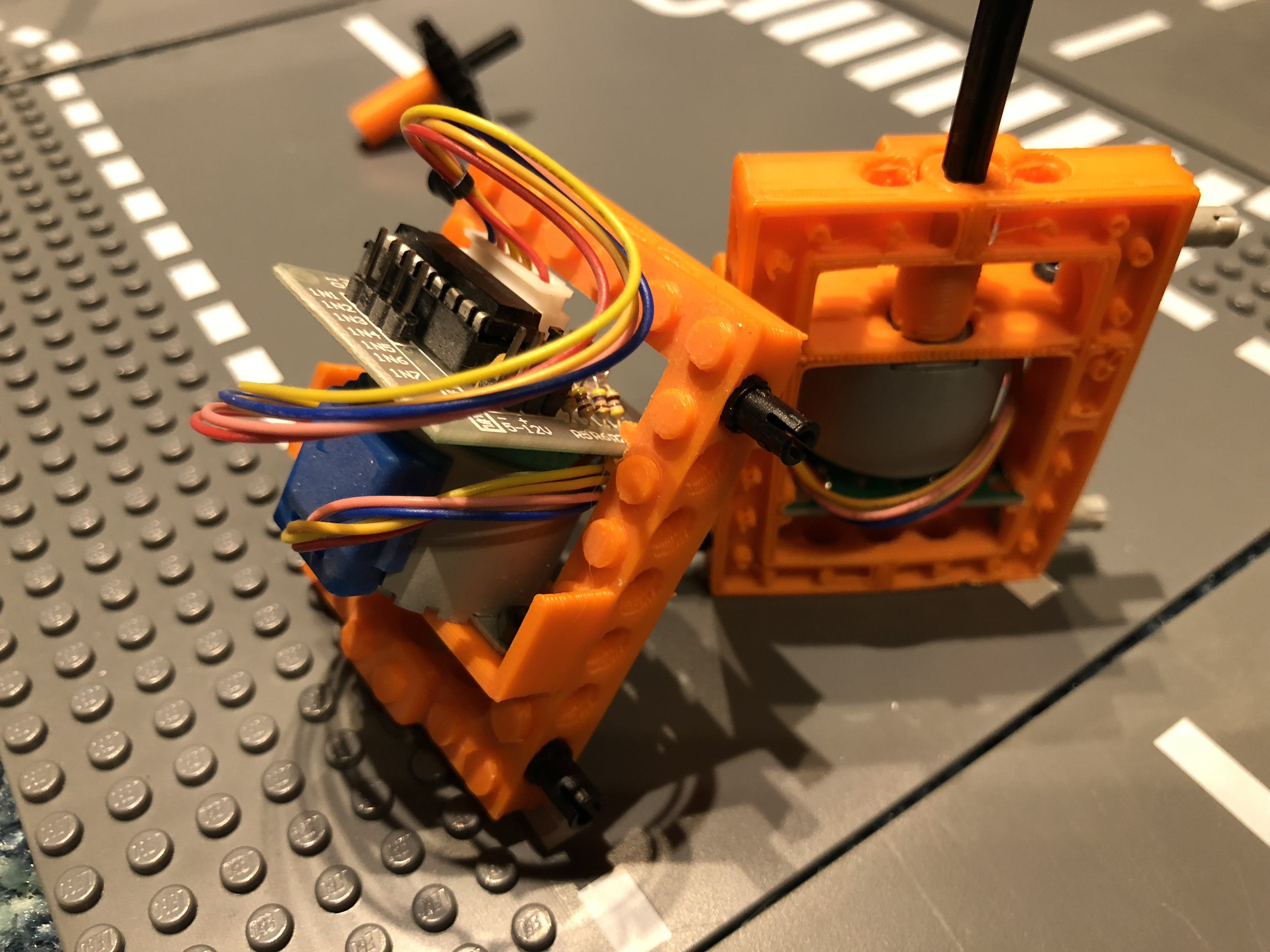 Stepper controller board sits together with the motor.