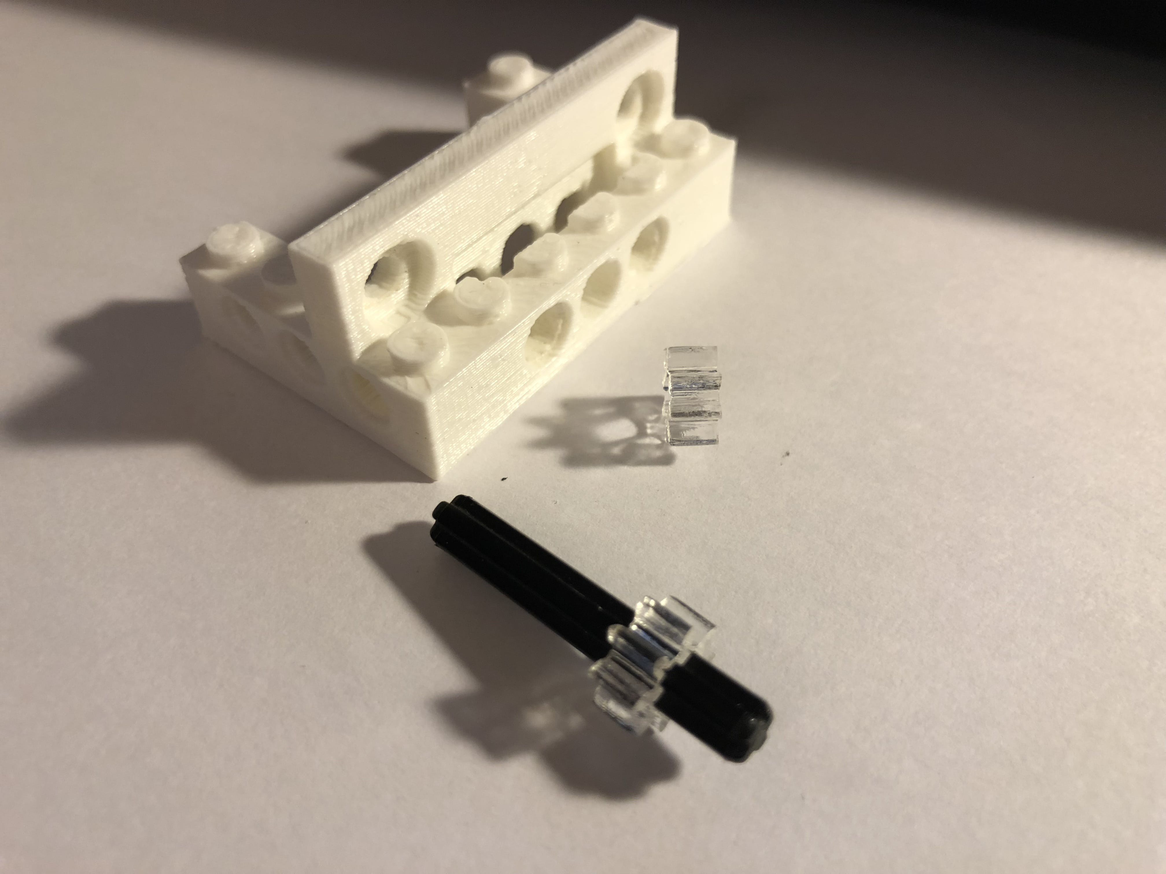 3D-printed stepper lego brick. Laser cut gears (lego compatible).