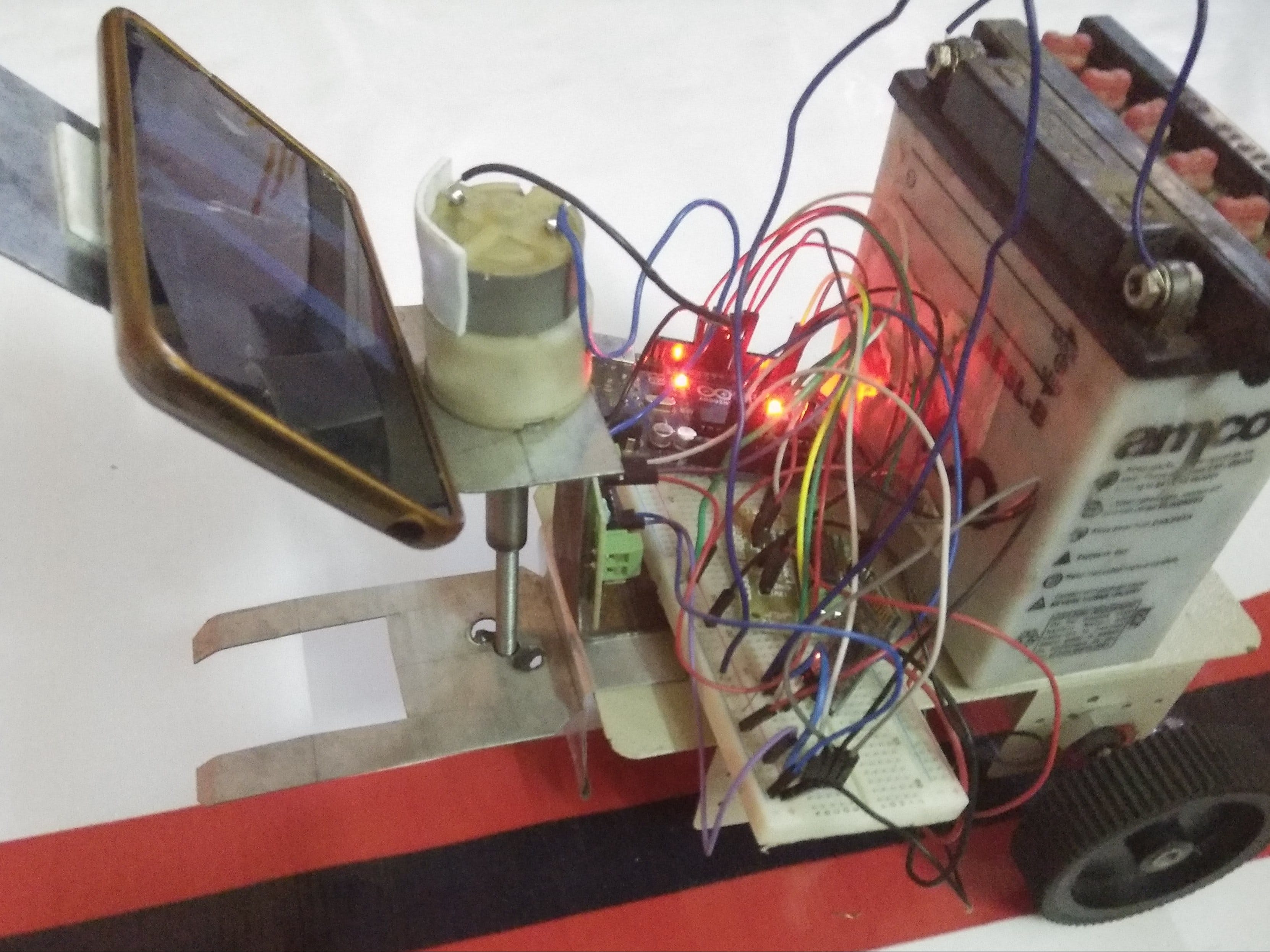 Vision-Based Self-Driving Pick and Place Robot