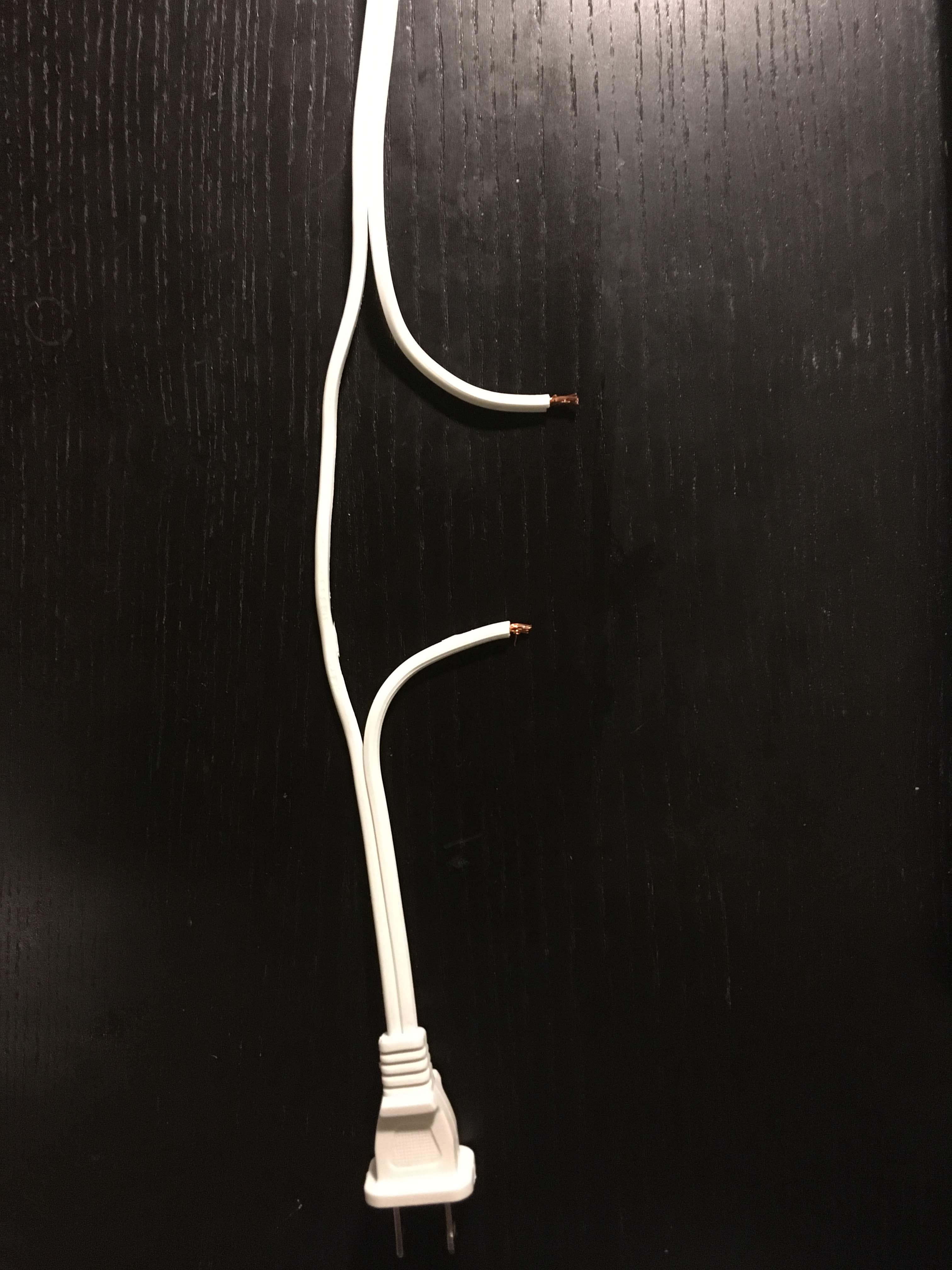 A split extension cable. The other wire is untouched.