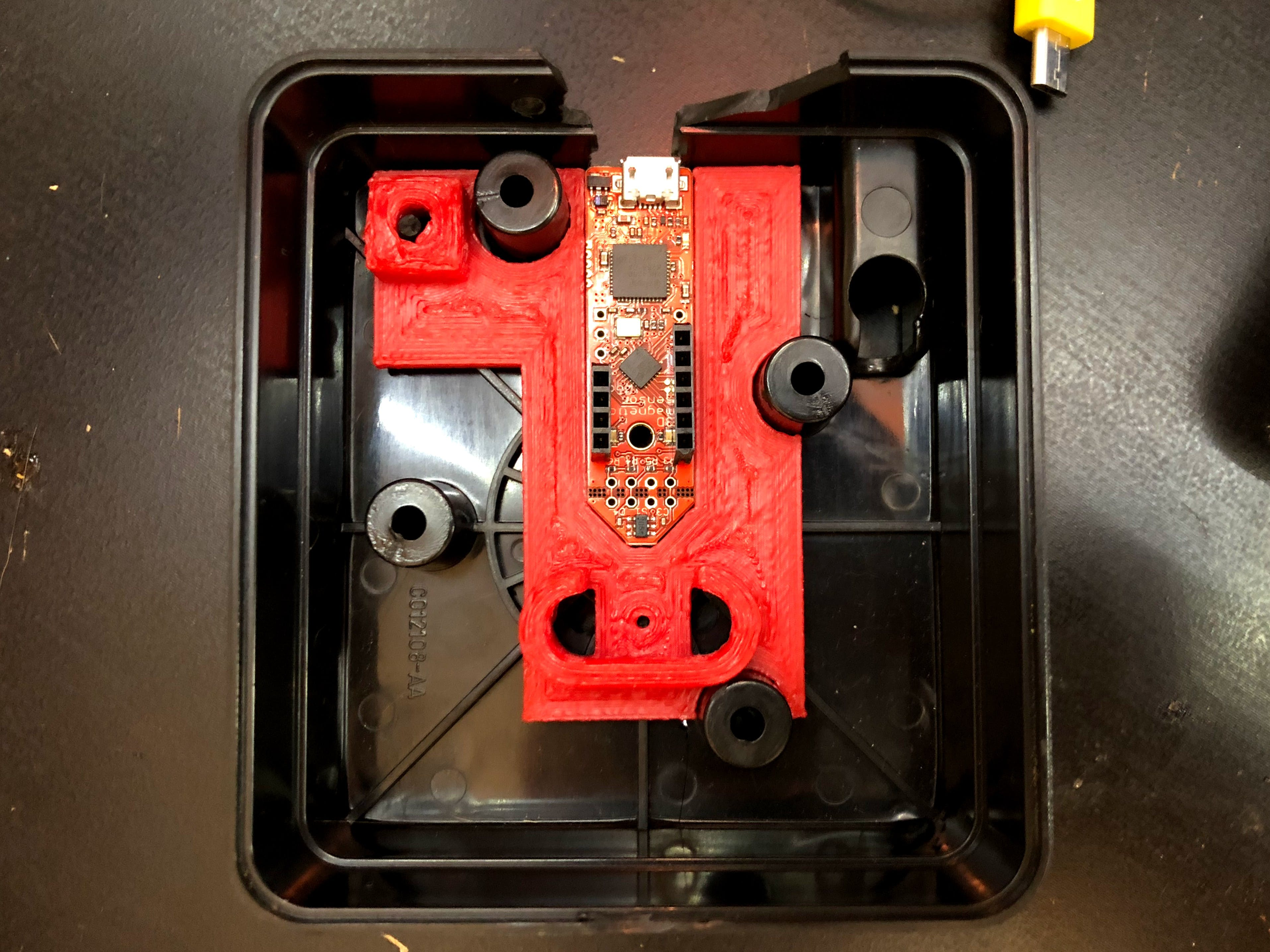 3D-printed adapter to hold the evaluation board