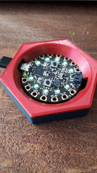 Adafruit's Circuit Playground in a 3D printed case.