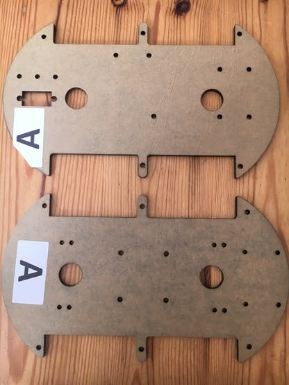 2 similar acrylic plates for - one has an additional section
