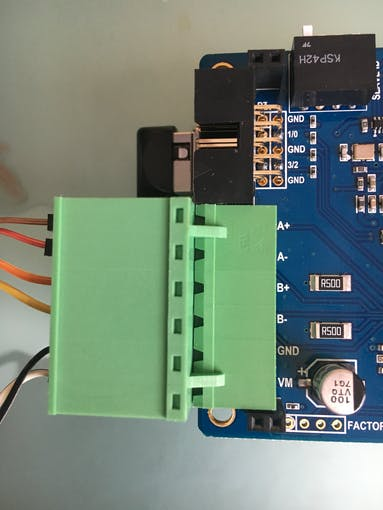 Put the stepper on the green terminal with its own voltage