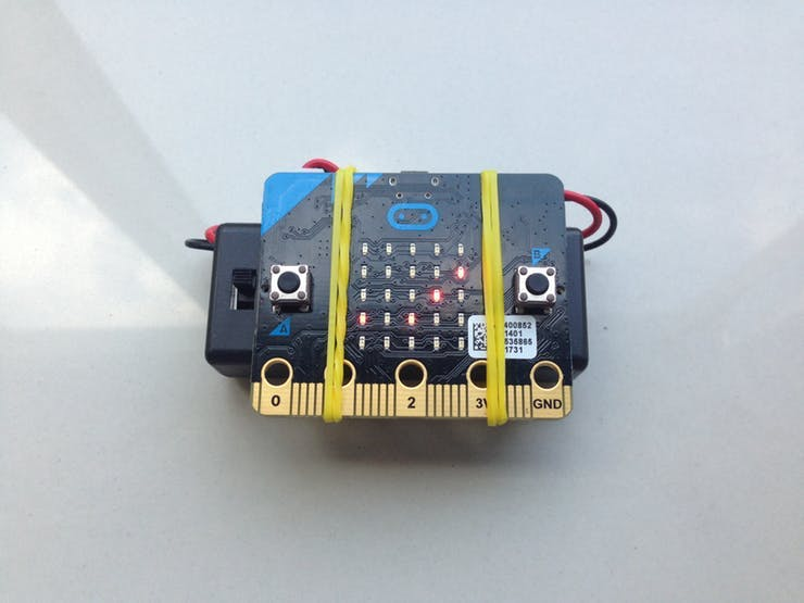Fully assembled Micro:bit with triple AAA battery using rubber band