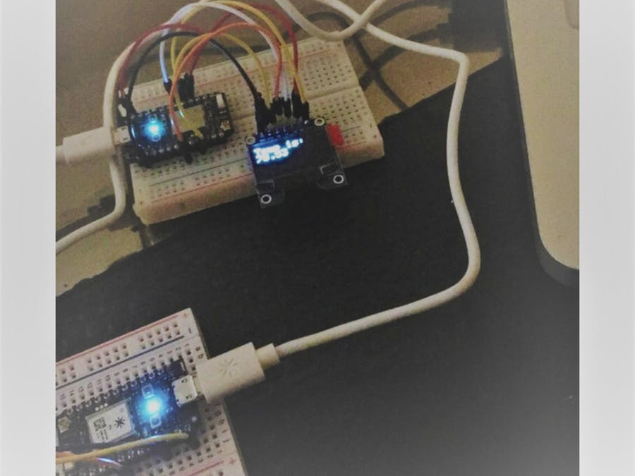 Temperature Monitor and Display with Two Particle Photons