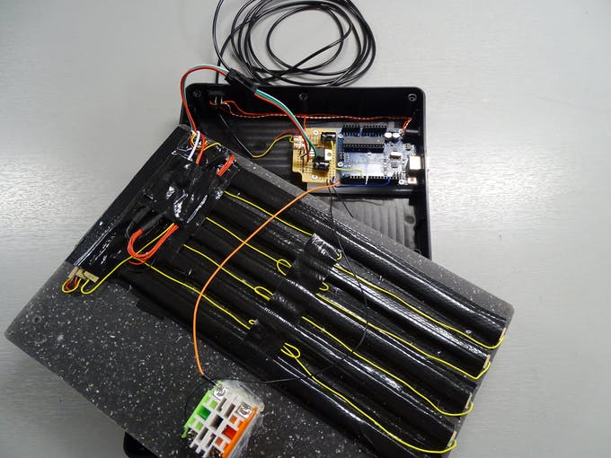 The complete assembly of the scoreboard (including the Arduino board and 5V regulator)