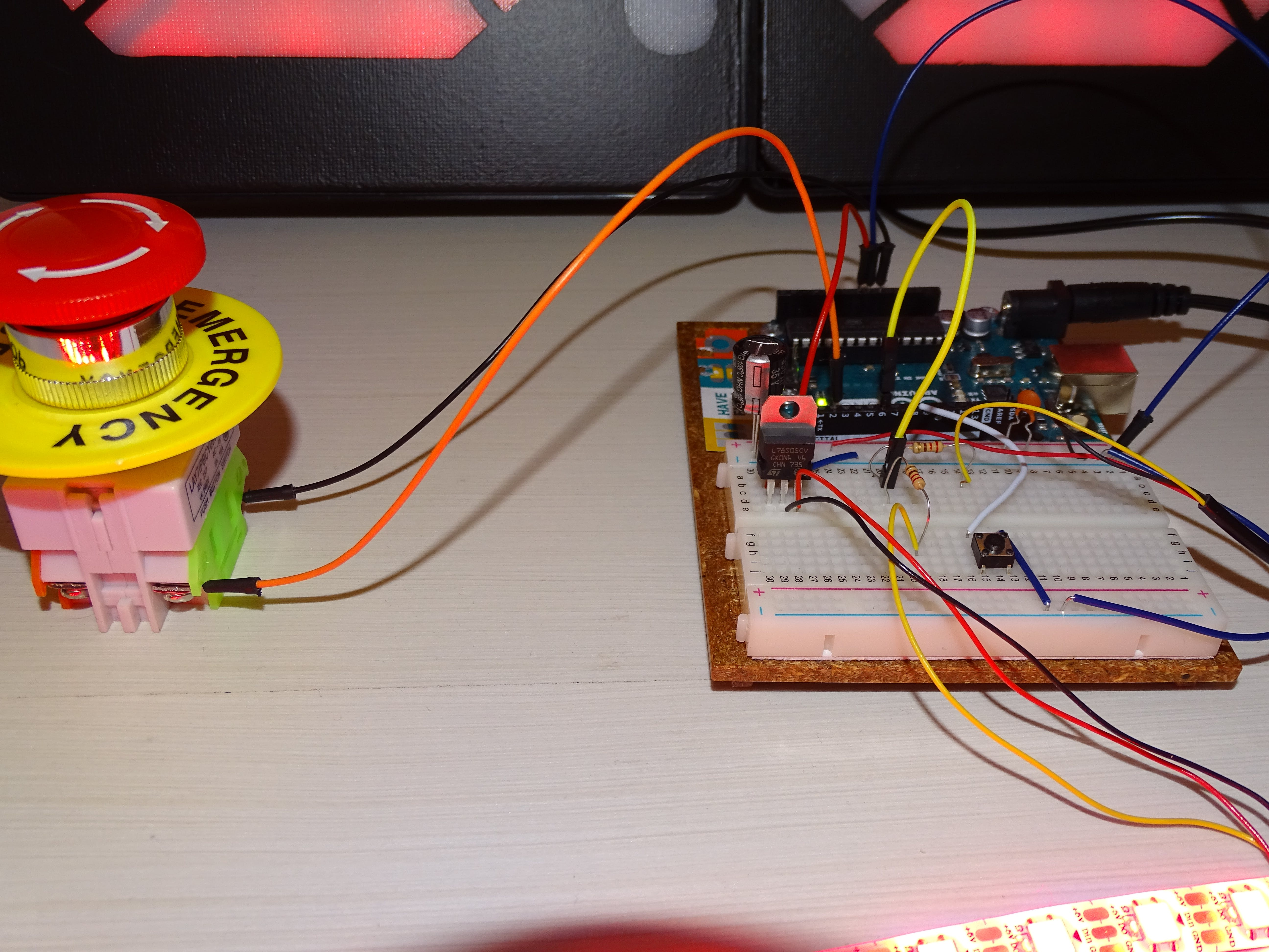 Breadboard set up with 7-segment displays and WS2812 Led trip connected in paralel