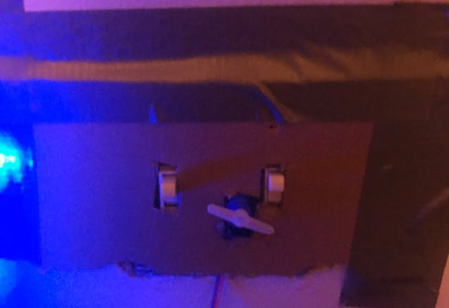 Figure 2: Servo Controlling the Light Switch