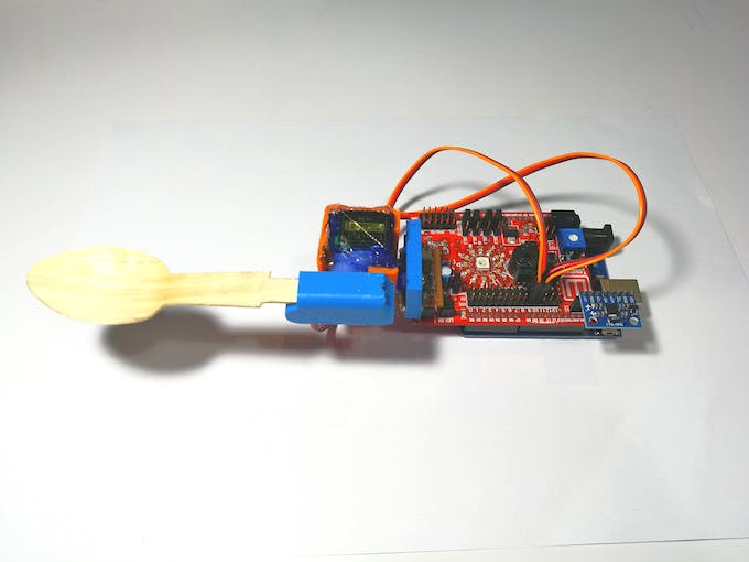 Spoon and Servos Mounted on Idiotware Shield