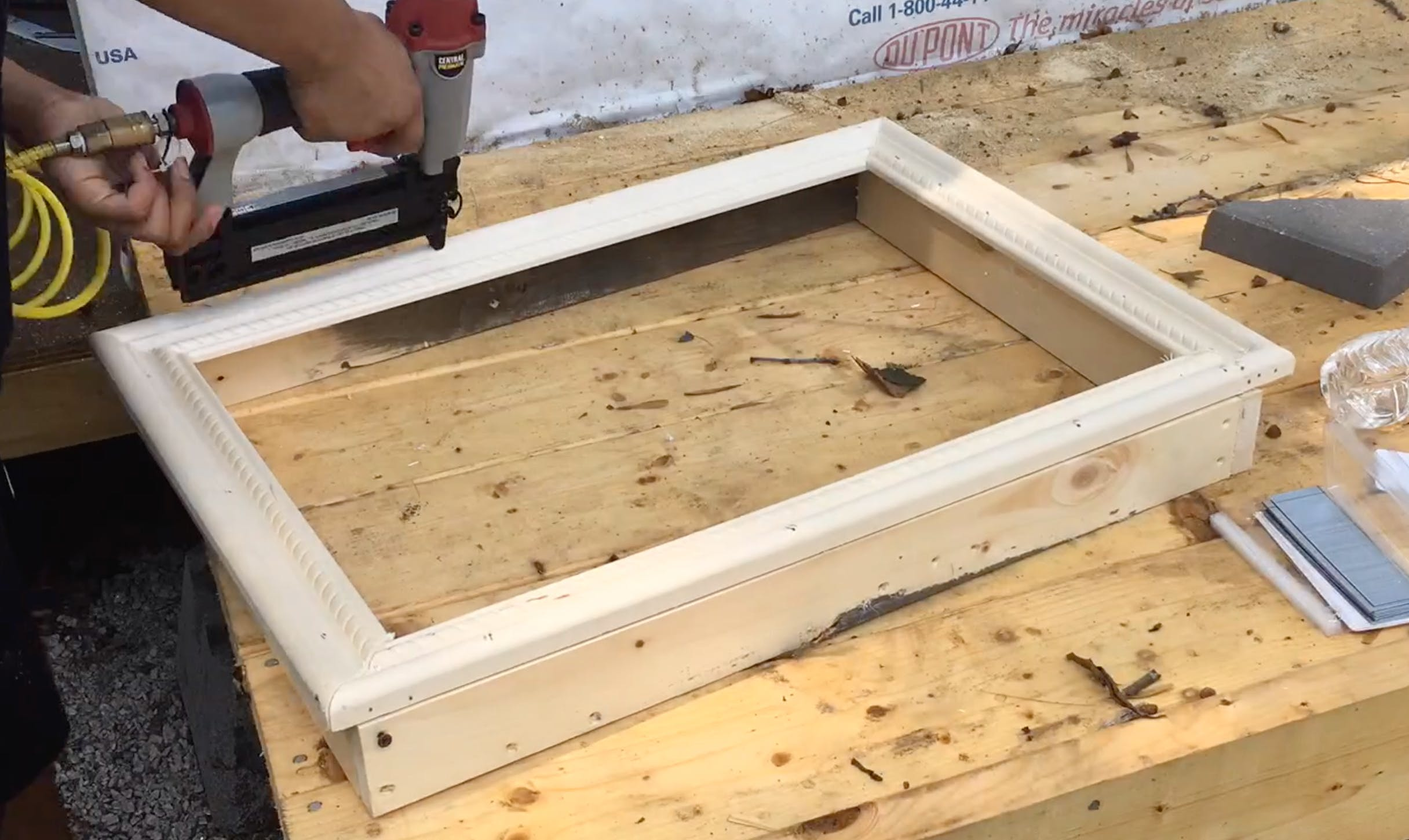 attaching the moulding onto the frame