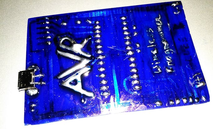 Pads and AVR logo with solder