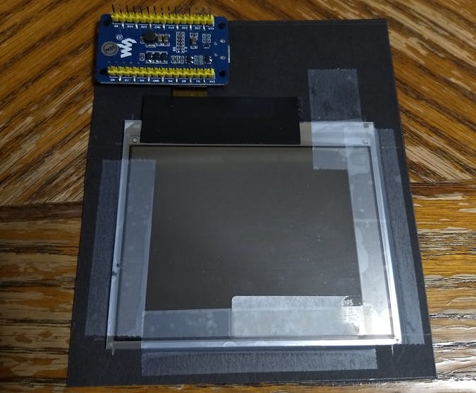 The taped-down display and driver board.