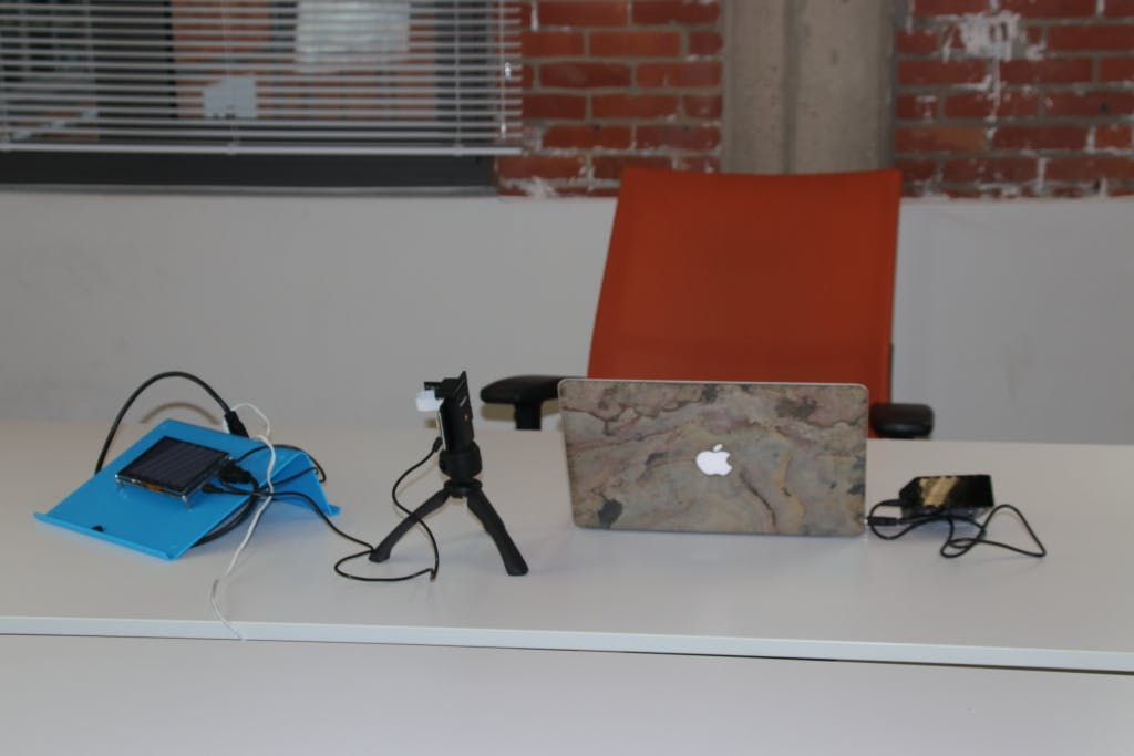 The test platform positioned together with a small laptop. Back view
