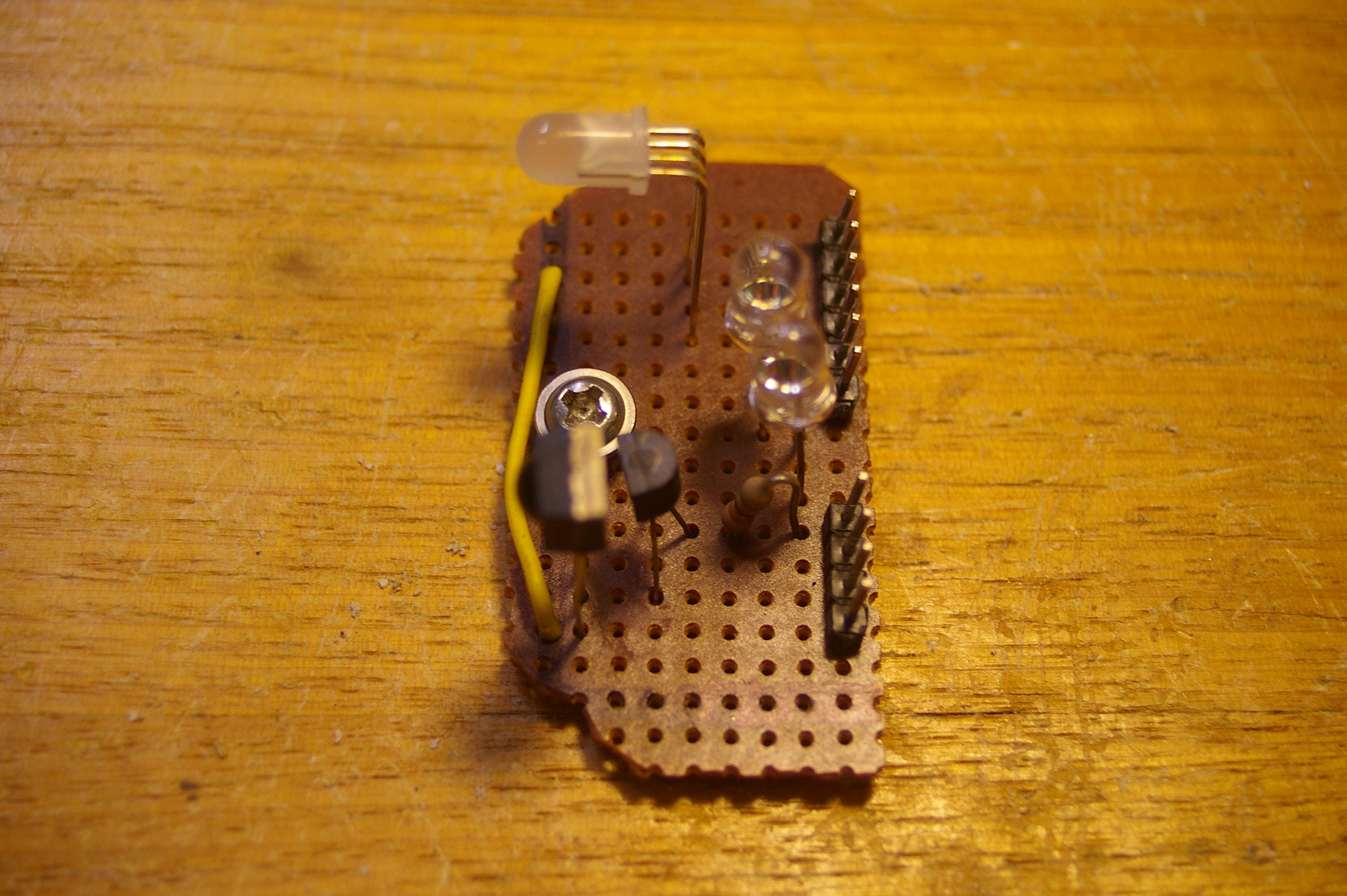 The IR transceiver assembly and status LED