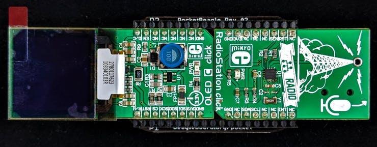 Example Click Boards™  plugged into BeagleBoard.org® PocketBeagle®