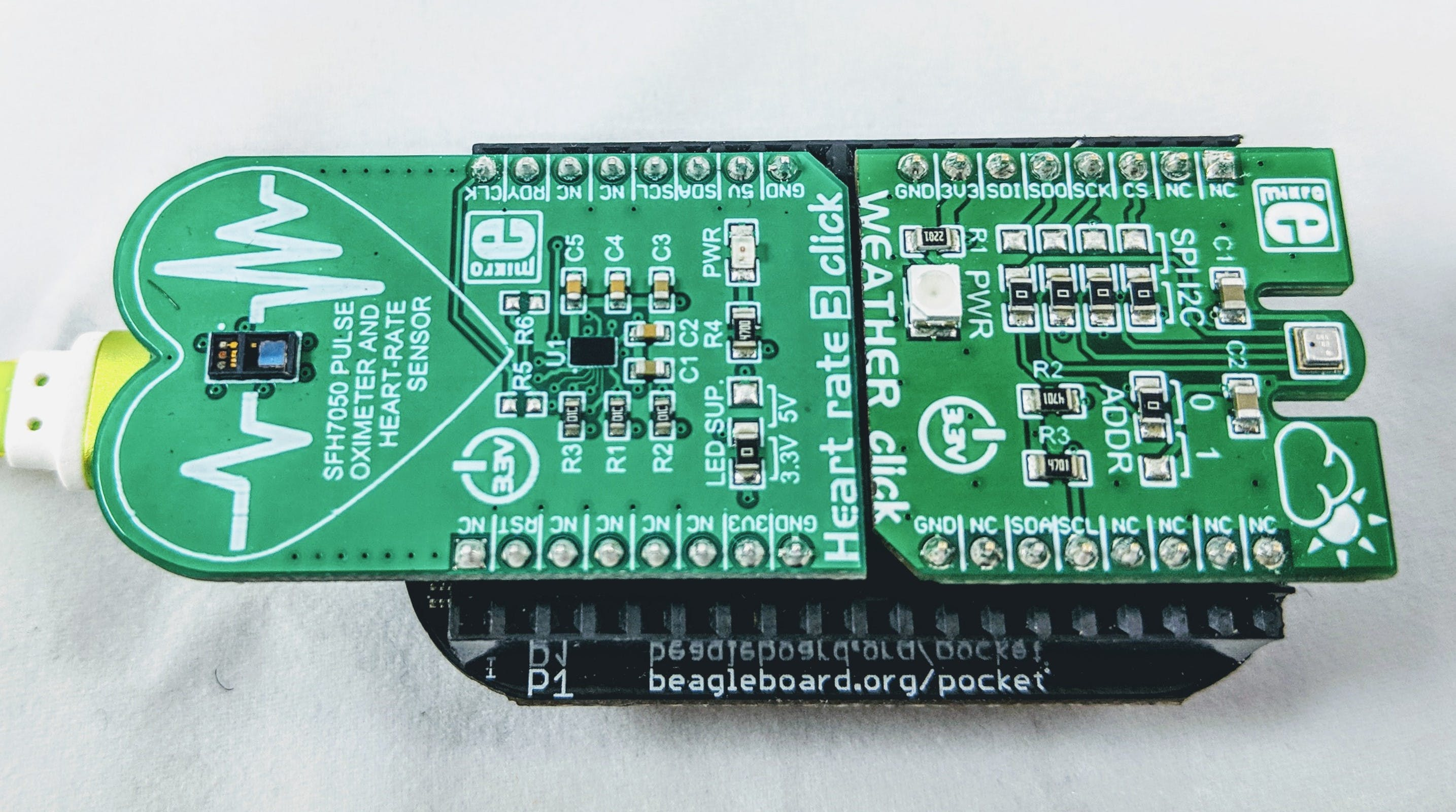 Heart Rate 3 and Weather Click Boards installed on PocketBeagle®