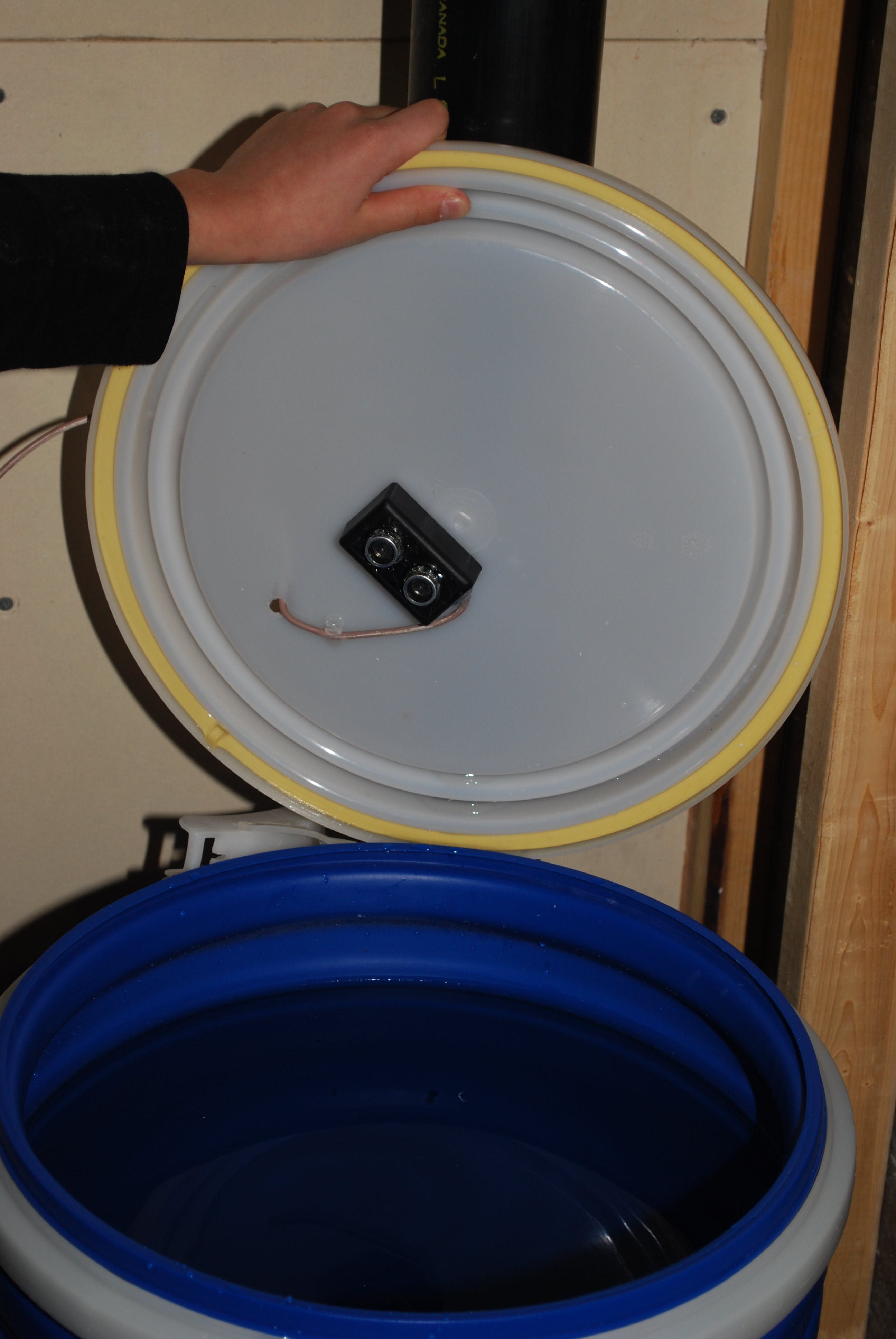 Water level ultrasonic sensor. Thanks to my son for help taking pictures :)