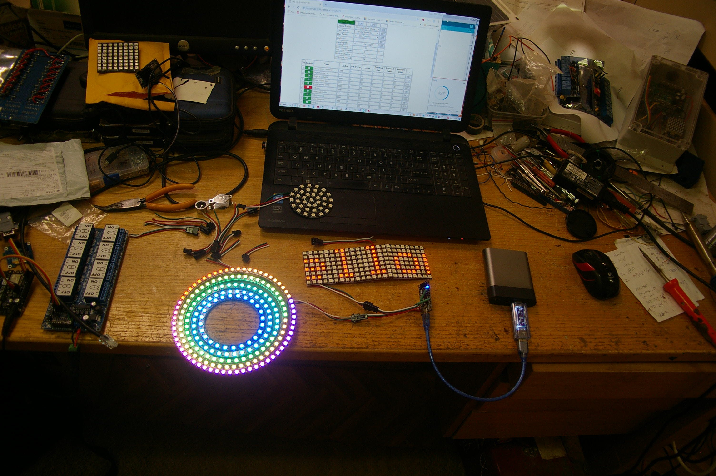 Two strings sort of going via USB of  board. A test interface on the laptop.