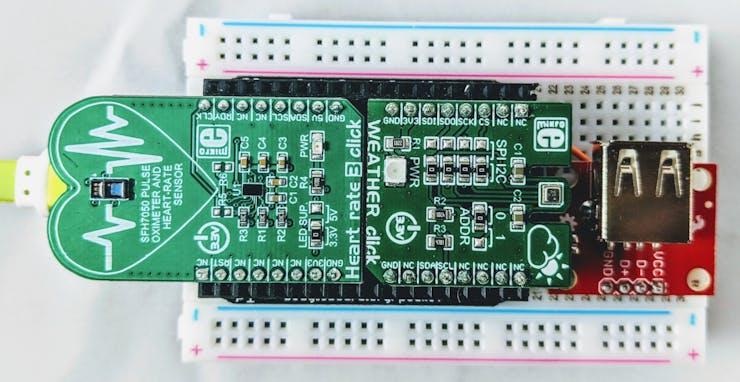 PocketBeagle® with click boards and USB host port